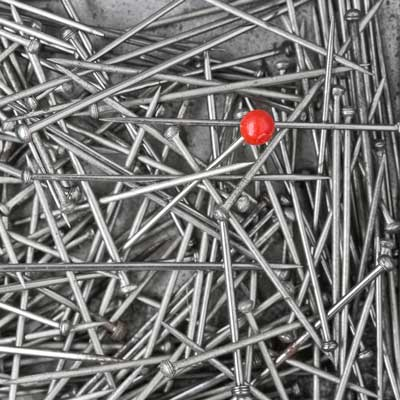 Red Pin amongst nails